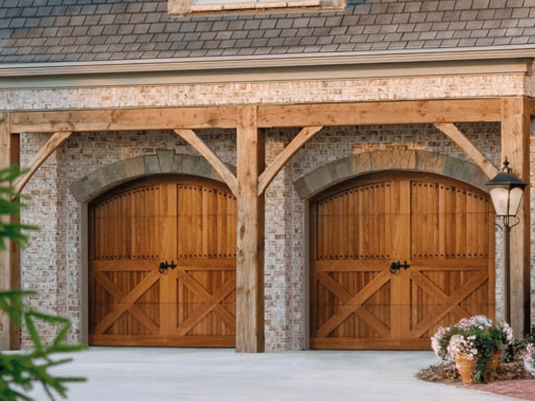 Wood carriage garage doors with natural finish