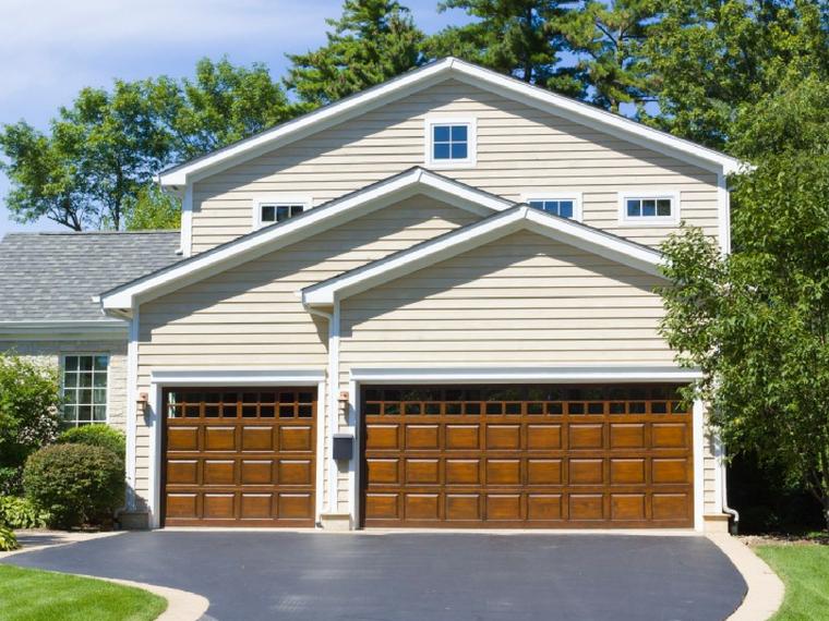 how to repair wood garage door panels